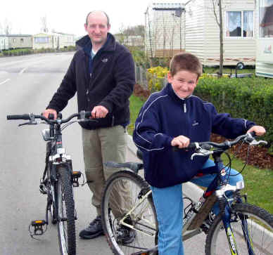 Father and son returning after a bike ride from Presthaven Sands