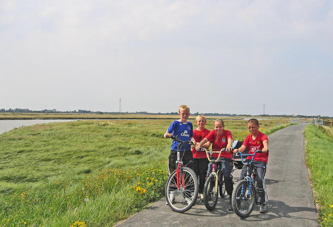Photo of 4 children with bikes on the Afon Clwyd cycle path
