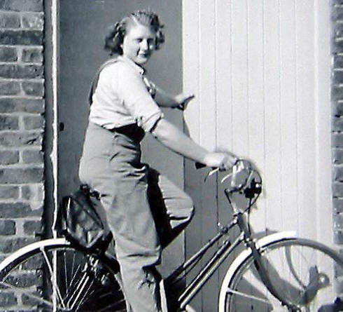Photo of Ann as a landgirl on a bicycle