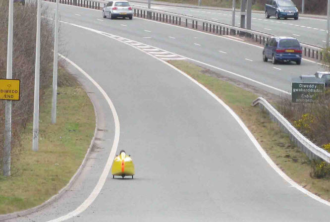 Photo of recumbent tricycle entering the A55 dual carriageway expressway