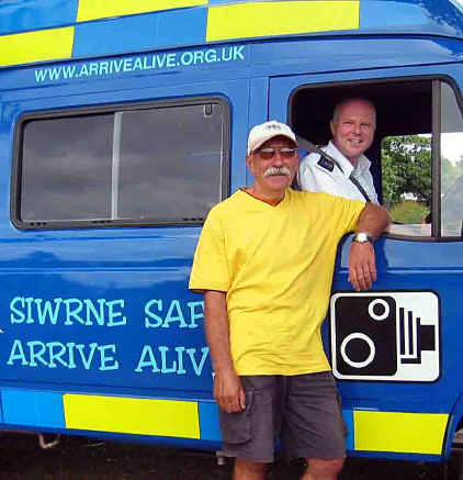 Local ctc member by open window of a police Arrive Alive van