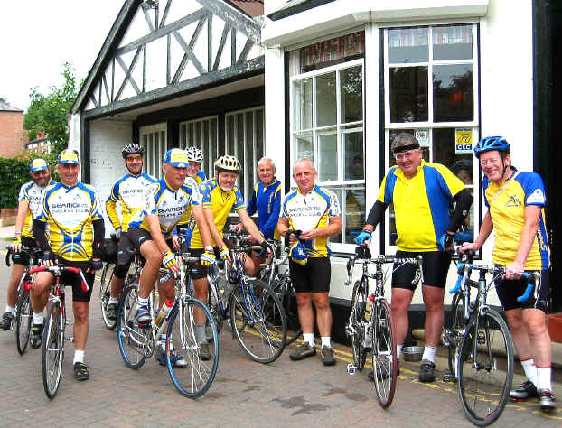 Modern photo of cyclists in front of Blue Moon Cafe, Chester