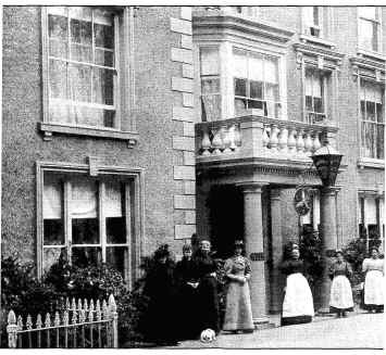 Photo of staff in front of a Llanfairfechan hotel over a century ago