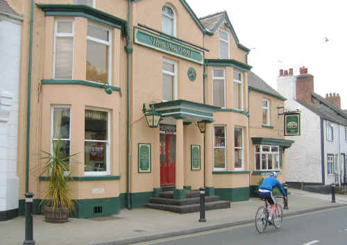 Photo of a cyclist passing in front of New Inn, Rhuddlan 2005