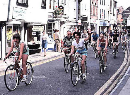 Photo of groups of bareheaded cyclists