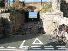 A cycle path where cyclists have priority when the path crosses another leading to the beach near Penmaenbach