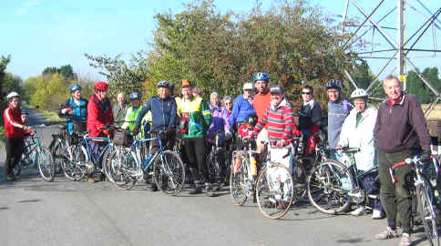 Large group of cyclists pose on cycle path to Chester