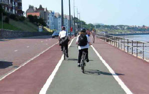 Children cycling on cycle path on Colwyn promenade