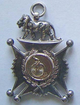 Photo of a medal with Penny Farthing and Lion above