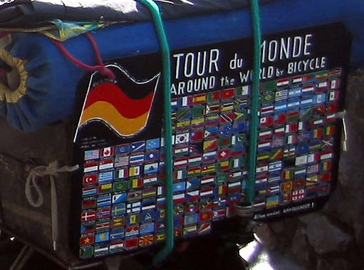 On the back of Heinz Stucke's bike is a board with over 200 small flags of the countries he has visited