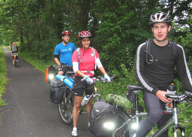 Photo of three young touring cyclists