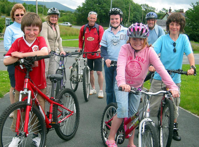 Photo of a group of cyclists, including children, on Lon Eifion cycle path