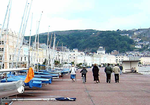 Llandudno prom with pedestrians and child cyclist