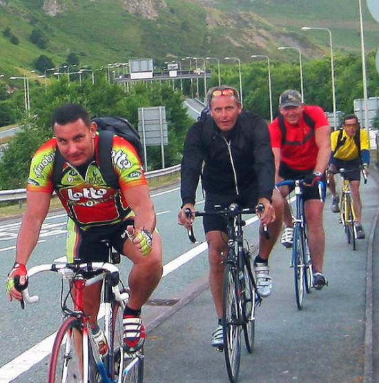 Photo of 4 cyclists on the A55 sliproad at Conwy