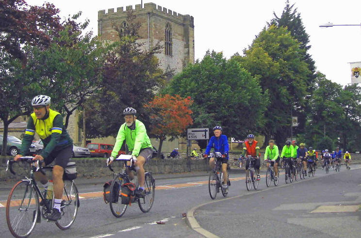 Photo of cylists in St Asaph on President's Ride