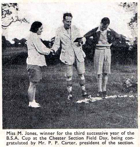 1930s Photo of Miss M Jones being awarded a cup for the third successive year