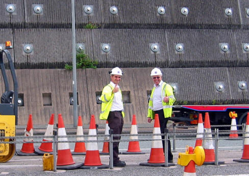 Photo of 2 workmen showing thumbs up