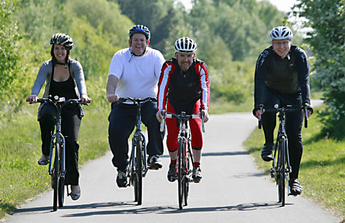 Photo of Paul Rutt cycling with friends