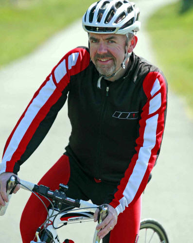 Photo of Paul Rutt on bicycle