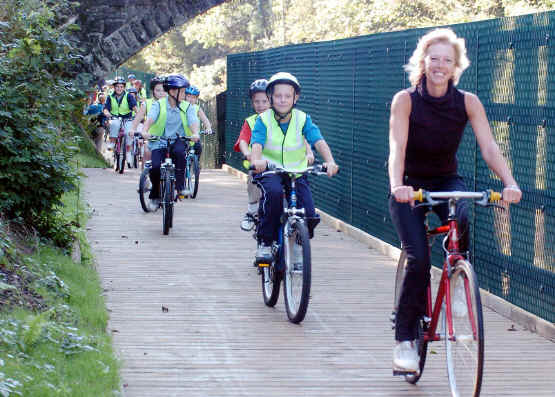 Tamsin Dunwoody AM cycling with large group of children