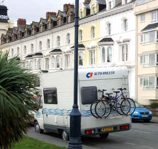Llandudno seafront hotels with a motor caravan parked with bikes attached to rear