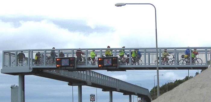Photo of cyclists lining a section of the Pen-y-Clip bridge that overlooked the opening ceremony