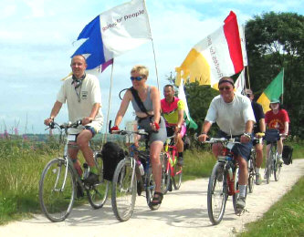 Cyclists with flags on the Tissington Trail