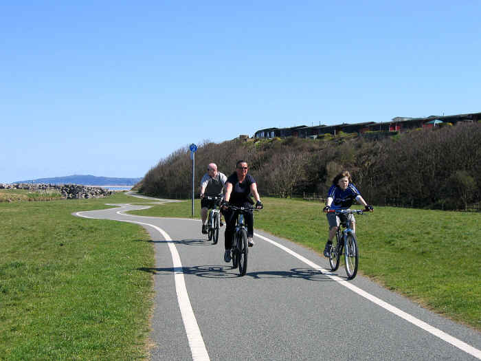 Cyclists heading towards Llanddulas