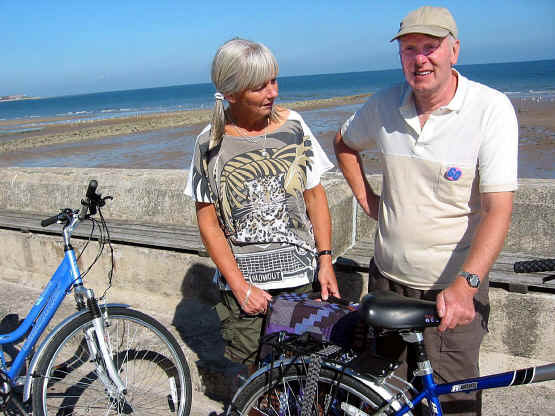 Husband and wife with their bikes on seafront at Rhos-on-Sea