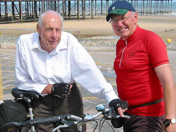Maurice Clarke and Roy Spilsbury, website manager and editor, pose near Colwyn prom before starting off on a group ride