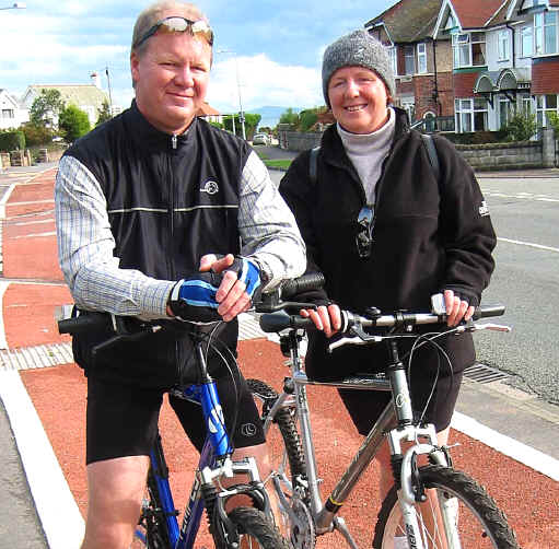 David Sutcliffe and his wife with their bikes on the cyclepath