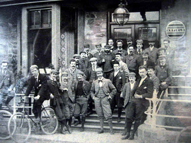 Group of 30 or so members of the Anfield Bicycle Club pose in 1896 outside the Glan Aber Hotel, Betws-y-Coed. The hotel has the club's plaque on the wall near the entrance.