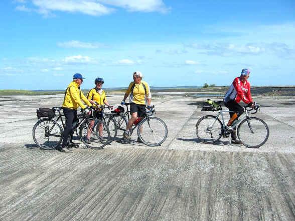 four cyclists on the open concrete space where the Point of Ayr colliery once stood