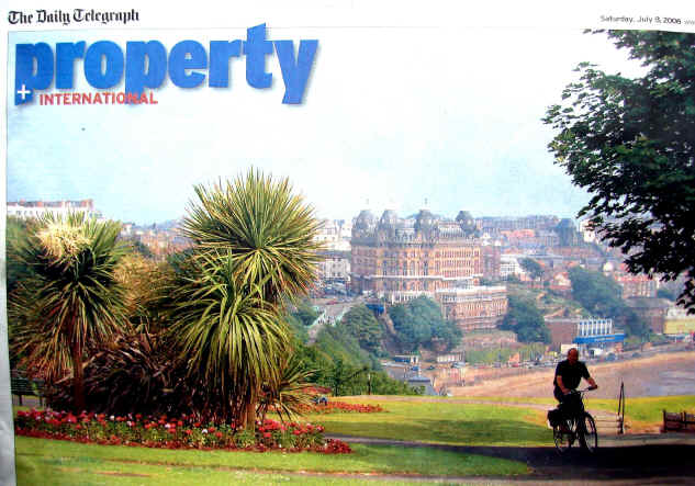 Property advertisement showing a view of Scarborough with a cyclist in the foreground