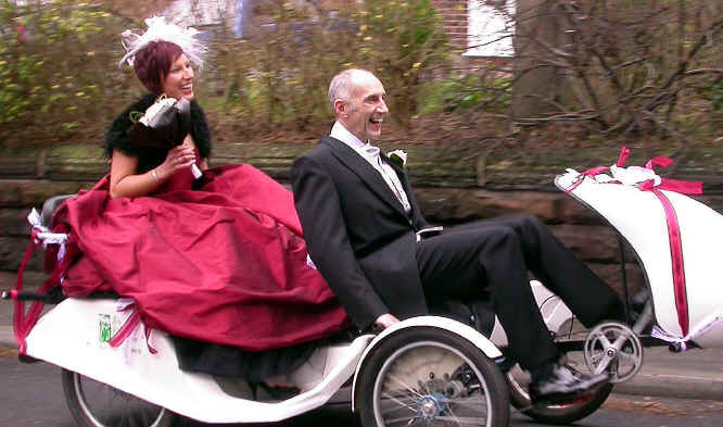 Warrington cycling campaigner, Rod King, in morning suit takes his daughter on a four wheel pedicab to  her wedding