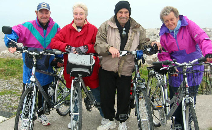 Photo of 4 people with their bikes