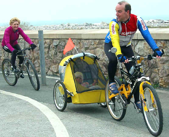 Rhyl's Geoff and Heidi Harrison taking their todler in a bike buggy