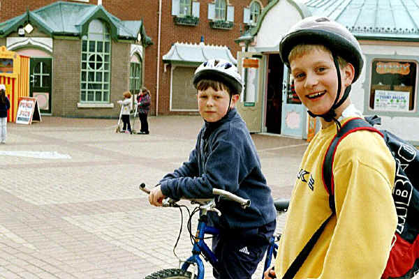 Two child cyclists pause at Rhyl's Children's Village during a 20 mile bike ride