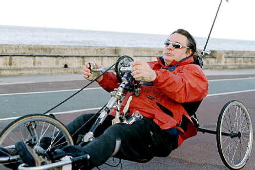 Derej Churm of Rhos on Sea on his recumbent cycle, ensuring that disability does not prevent him from taking exercise and meeting friends