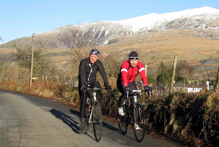 Photo of two cyclists with Snowdon in background