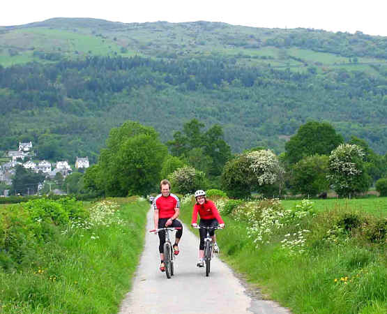 Peter and Sarah Cawley cycle on the delightful traffic free path from Trefriw to Llanrwst crossing the Afon Conwy