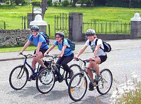 Ysbyty Gwynedd Health workers, Louise, Pauline and Fiona from New Zealand, head on bikes for the mountains around Aber Falls
