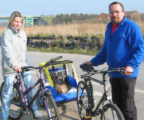 Julie and Steven Paziuk of Batley carry their two dogs, who suffer from arthritis, in a cycle trailer