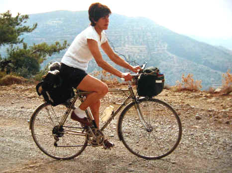 Lady cycling in the mountains of Crete