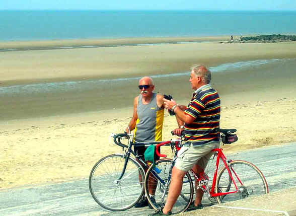 Two retired members of CTC with bikes on Ffrith beach, Prestatyn