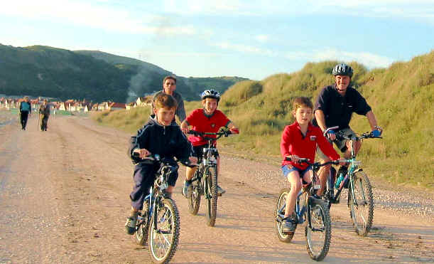 family of cyclists starting to use Conwy Estuary cycleway while still under construction