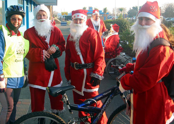 photo of some santas before a charity ride