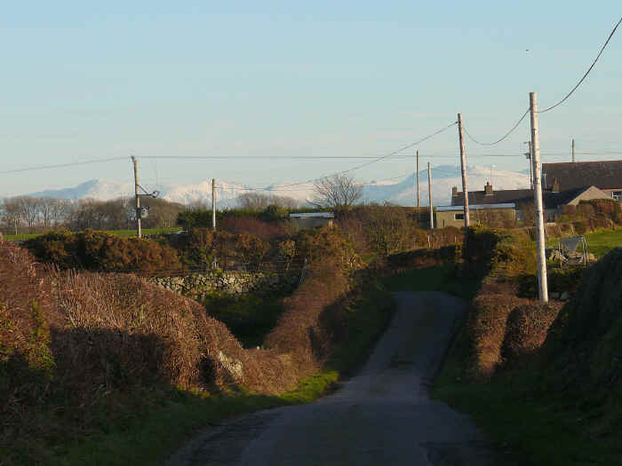 Lane with Snowdonia in the background