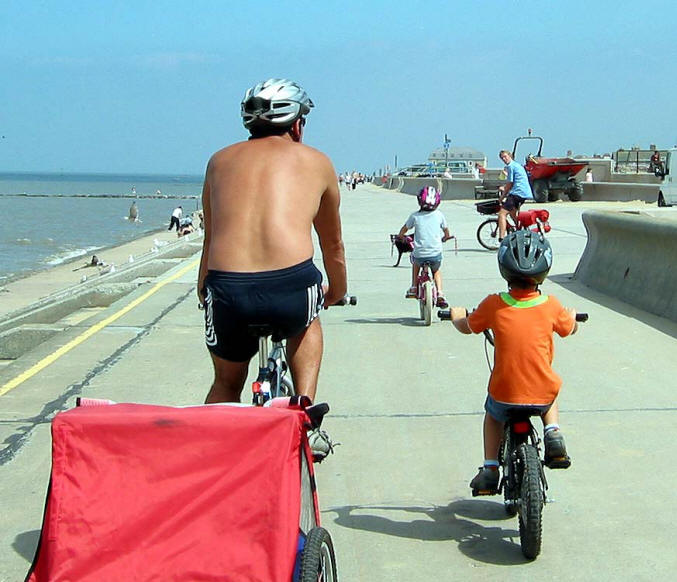 Photo of family cycling on Prestatyn promenade