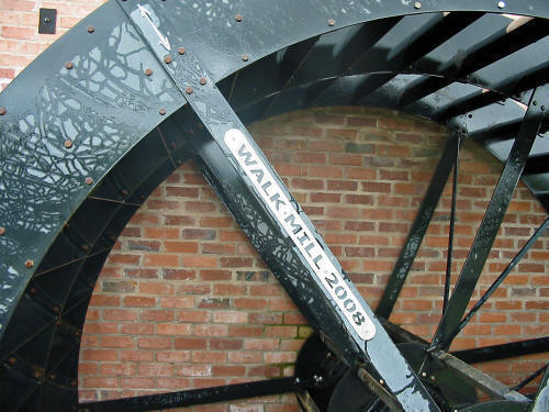 Photo of part of Walk Mill's wheel showing name